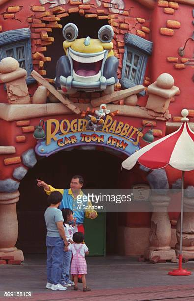 Disneyland employee turns away a family from the closed Roger Rabbit's Cartoon Spin ride in Toon Town Saturday after a four–year old boy was...