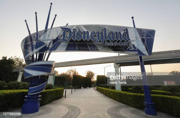 Disneyland sign is posted at an empty entrance to Disneyland on September 30, 2020 in Anaheim, California. Disney is laying off 28,000 workers amid...