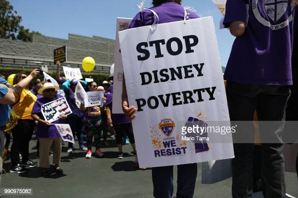 Disneyland workers and supporters rally while protesting low pay and calling for a living wage at the Disneyland entrance on July 3 2018 in Anaheim...