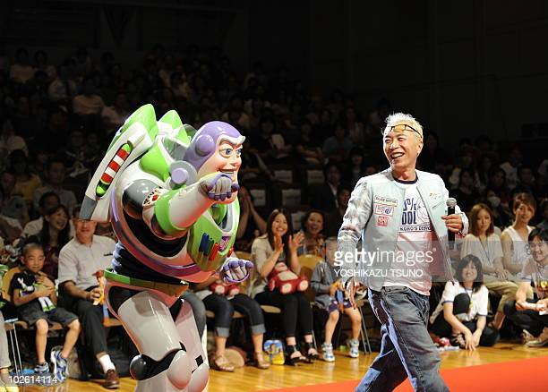 Disney/Pixar's new 3D animation movie Toy Story 3 character Buzz Lightyear smiles with Japanese voice actor George Tokoro for dubbed Japanese version...