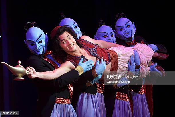 'Disney's Aladdin –In a scene from 'Friends Like Me' Aladdin portrayed by Michael K Lee is held by genies A Musical Spectacular' at Disney's...