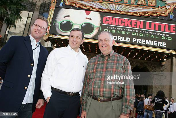 """Disney's David Stainton , Robert Iger and Richard Cook pose at the premiere of Disney's """"Chicken Little"""" at the El Capitan Theater on October 30,..."""