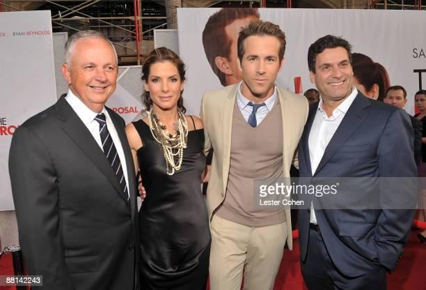 "Disney's Dick Cook, actress Sandra Bullock, actor Ryan Reynolds, and Disney's Oren Aviv arrive on red carpet of the Los Angeles premiere of ""The..."