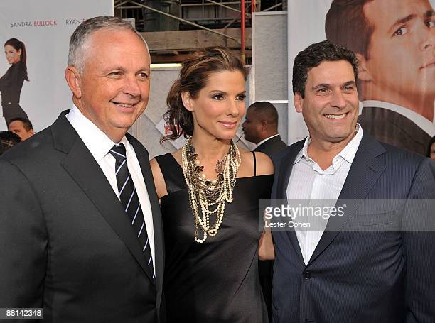"""Disney's Dick Cook, actress Sandra Bullock, and Disney's Oren Aviv arrive on red carpet of the Los Angeles premiere of """"The Proposal"""" held at the El..."""