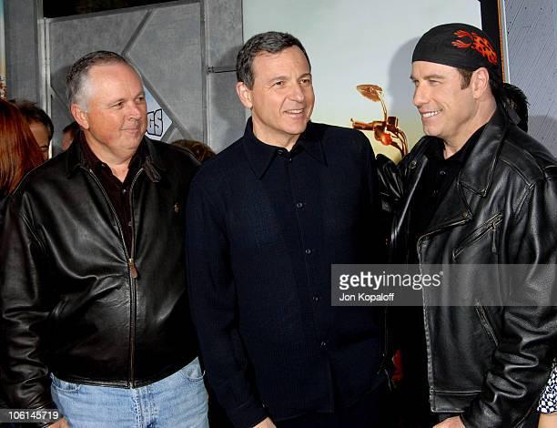 Disney's Dick Cook Disney's Robert A Iger and John Travolta