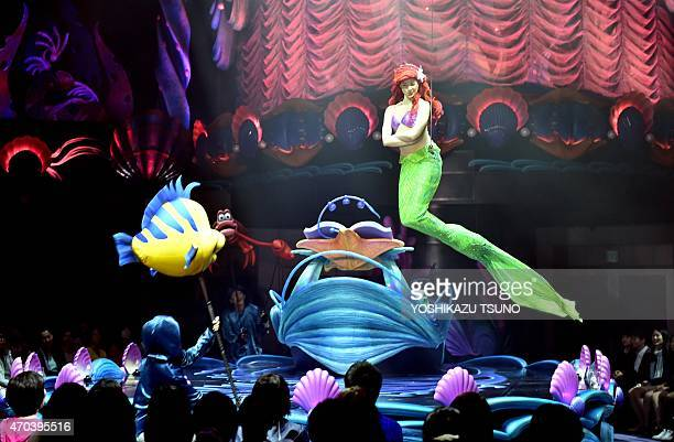 Disney's Little Mermaid character Ariel sings and displays wireaction performance in the air during the press preview of the new attraction King...