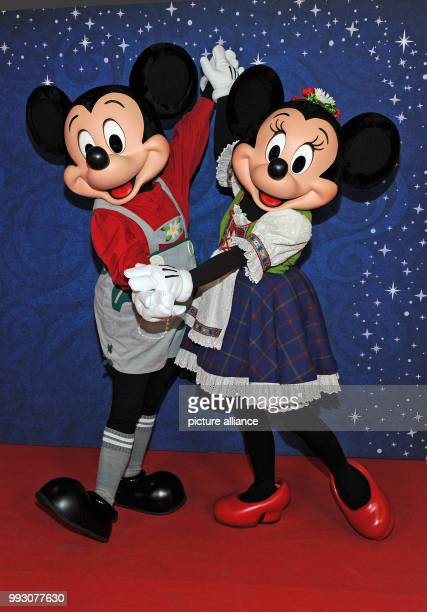 Disney's Mickey Mouse and Minnie Mouse photographed dancing during the preopening of the new Disney Store in Munich Germany 08 November 2017 The...
