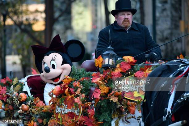 Disney's Mini and Mickey Mouse ride on a Walt Disney World carriage during the 99th 6ABC/Dunkin' Donuts Annual Thanksgiving Day parade in...