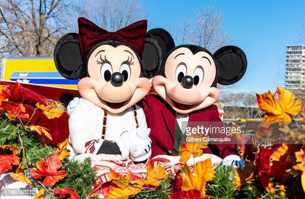Disney's Minnie Mouse and Mickey Mouse attend the 100th 6abc Dunkin' Donuts Thanksgiving Day Parade on November 28 2019 in Philadelphia Pennsylvania