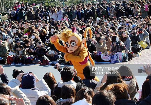 Disney's monkey character Abu performing to mark the upcoming Year of the Monkey in the Chinese zodiac greets guests during the theme park's annual...