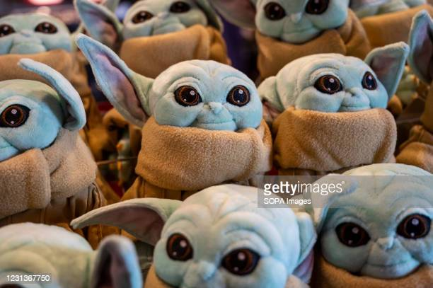 Disney's Star Wars merchandise stuffed toys depicting Grogu character, commonly known as Baby Yoda, from the Disney+ TV series The Mandalorian are...
