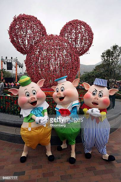 Disney's Three Little Pigs pose in front of a cherry blossom Mickey Mouse at Hong Kong Disneyland on Thursday Feb 15 in Hong Kong China The Year of...