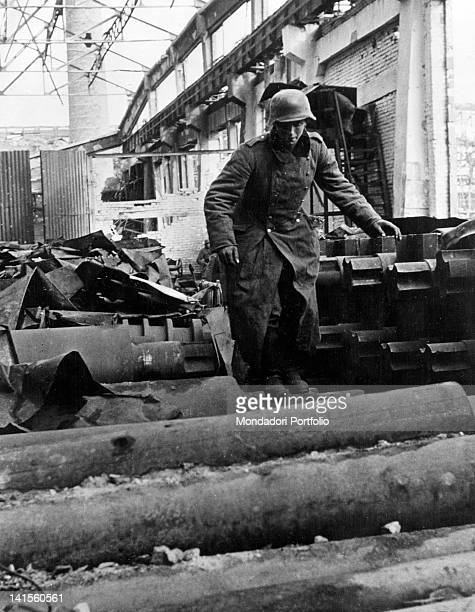 Dispatch rider running among the ruins of the industrial district of Stalingrad today Volgograd Volgograd November 1942