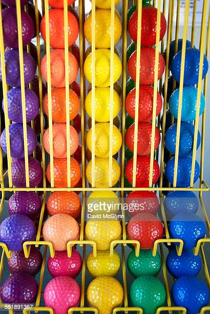 Dispenser full of colorful miniature golf balls
