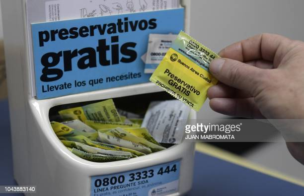 A dispenser offers free condoms at the Institute of Biomedical Research in Retroviruses and AIDS of the CONICET and the Buenos Aires University in...