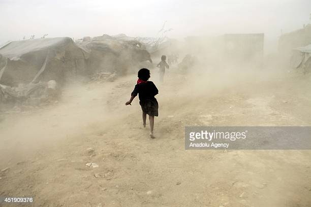 Displaced Afghan families from Helmand province live in their temporary shelter at a refugee camp in Kabul Afghanistan on July 9 2014 Around 160...