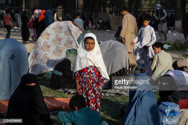 Displaced Afghans are seen at a makeshift IDP camp in Share-e-Naw park to various mosques and schools on August 12, 2021 in Kabul, Afghanistan....