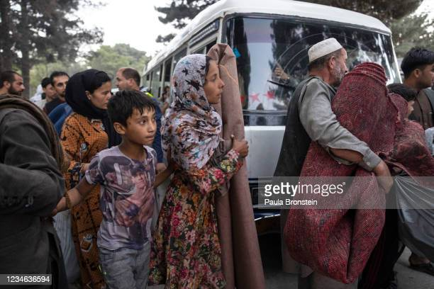 Displaced Afghans from the northern provinces are evacuated from a makeshift IDP camp in Share-e-Naw park to various mosques and schools on August...