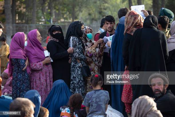 Displaced Afghans from the northern provinces register with authorities at a makeshift IDP camp in Share-e-Naw park on August 13, 2021 in Kabul,...