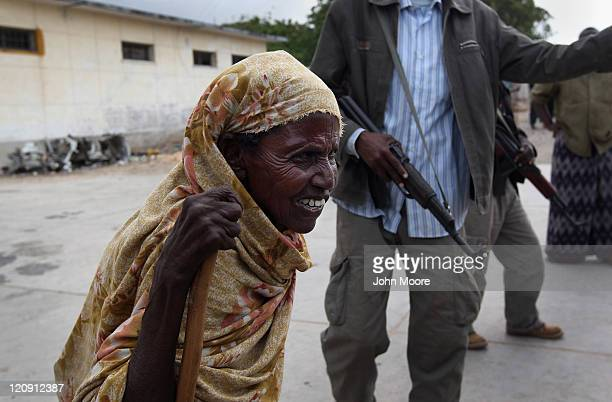 Displaced by drought and famine a woman enters the Banadir Hospital on August 12 2011 in Mogadishu Somalia Some 100000 Somalis have flooded into...