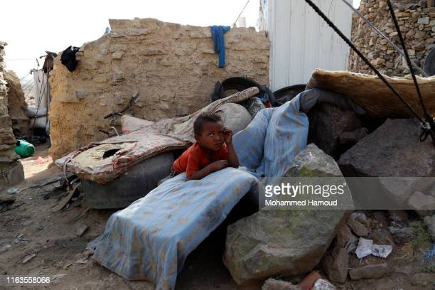 Displaced child who fled his home due to the war is seen at a camp on July 22, 2019 in the outskirts of Sana'a, Yemen. As a result of the over...
