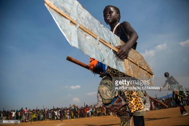 TOPSHOT Displaced children perform cultural songs to welcome the visit of US actor Forest Whitaker at the UN Protection of Civilians site in Juba...
