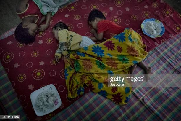 Displaced children sleeping inside a tent on the eve of Ramadan on May 15 2018 in Marawi Philippines With their homes destroyed and their properties...