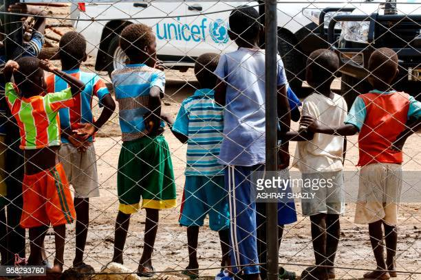 Displaced children stand at a camp for Internally Displaced Persons near Kadugli, the capital of Sudan's South Kordofan state during a United Nations...