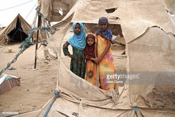 Displaced children stand in the shredded remains of tents in Abs settlement for internally displaced persons Located just 40 km from the frontlines...
