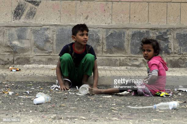 Displaced children who fled the war in Yemen's port city of Hodeida are seen at a school becomes their shelter on 23 2018 in Sana'a Yemen