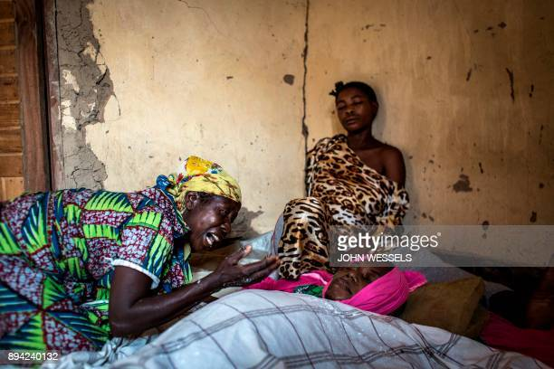 TOPSHOT A displaced Congolese family mourns the death of their loved one on December 17 2017 in Beni Paluku Mahire died of a sickness that first made...