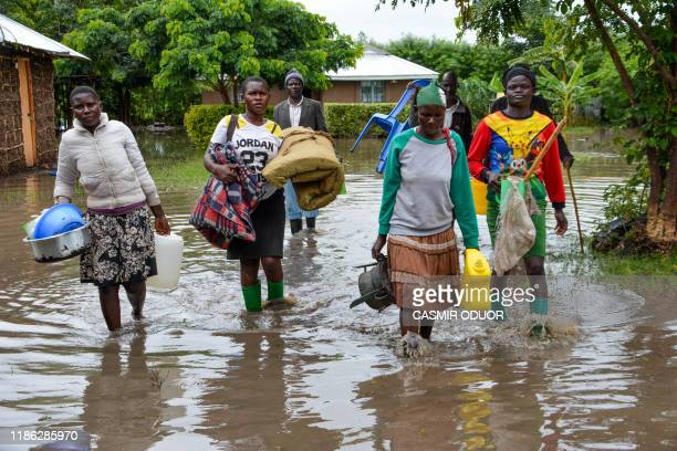 Displaced families flee to higher ground in K'akola village in Nyando subcounty in Kisumu after their houses were flooded on December 3 2019 At least...