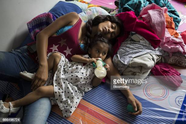A displaced family sleeps at an Indigenous Organization of Putumayo center after landslides in Mocoa Putumayo Colombia on Monday April 3 2017...