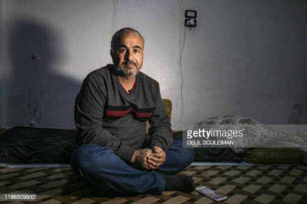 Displaced from the border town of Ras alAin Syrian Kurdish merchant Mustafa alZaim who's home a supermarket and several other stores were seized by...