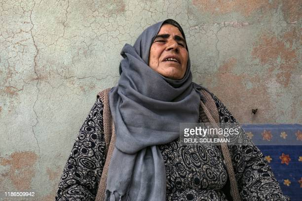 Displaced from the border town of Ras alAin Syrian Kurdish mother Shara Sido who's son son was allegedly shot dead by Turkeybacked Syrian fighters...