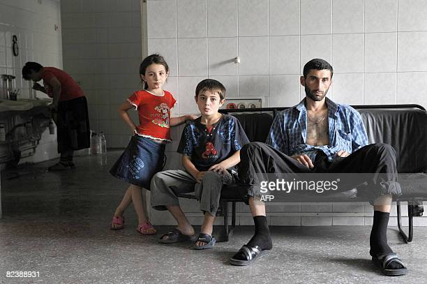 Displaced Georgians are seen in a temporary shelter in a former military hospital in the capital Tbilisi on August 17 2008 Refugees who fled many of...