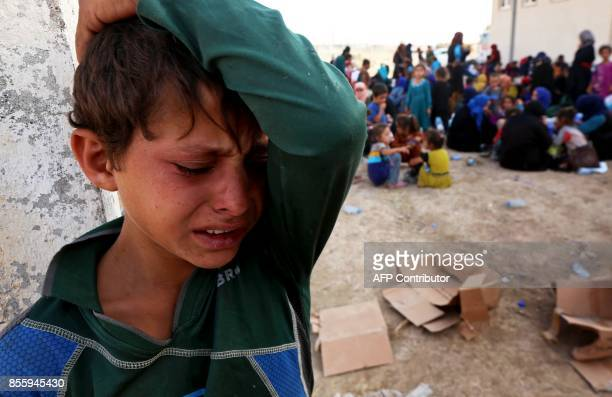 TOPSHOT A displaced Iraqi boy who fled the northern city of Hawija due to the government forces military operation to capture the city from Islamic...