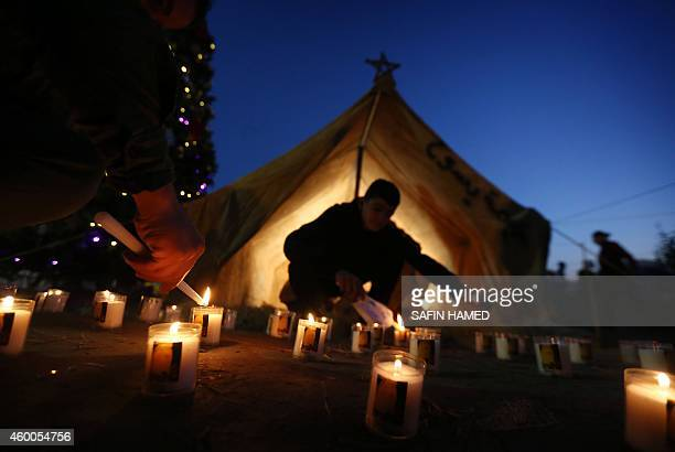 Displaced Iraqi Christians light candles in Arbil the capital of the autonomous Kurdish region of northern Iraq on December 6 to celebrate the...