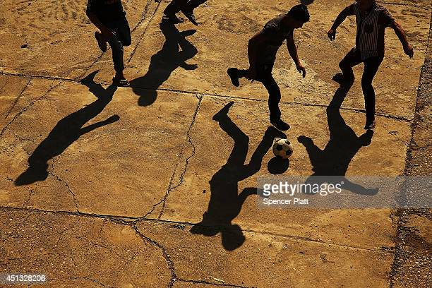 Displaced Iraqi Christians play soccer in the courtyard of Saint Joseph's church after having to flee their district on June 26 2014 in Erbil...