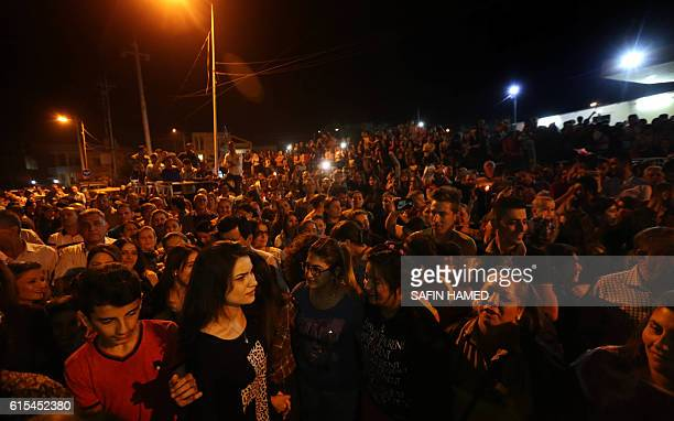 Displaced Iraqi Christians take part in celebrations on October 18 2016 in Arbil the capital of the autonomous Kurdish region of northern Iraq to...