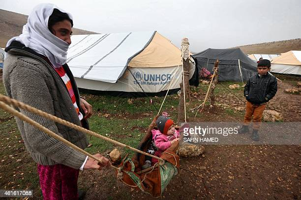 A displaced Iraqi from the Yazidi community who fled violence between Islamic State group jihadists and Peshmerga fighters in the northern Iraqi town...