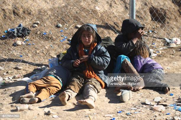 TOPSHOT Displaced Iraqi girls from western Mosul react upon their arrival at the Hammam alAlil camp on March 25 as Iraq's elite CounterTerrorism...