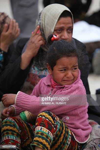 Displaced Iraqi Sunni girl who fled with many others the villages of of Albu Ajil and Al-Dor due to fighting between Islamic State group militants...