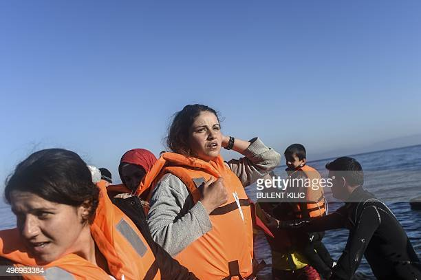 A displaced Iraqi woman from the Yazidi community who fled violence from Islamic State group jihadists arrives with other migrants and refugees on...
