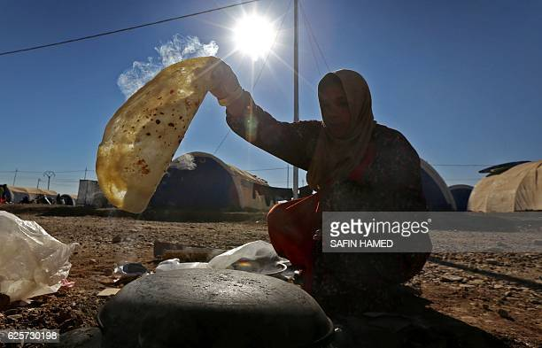 TOPSHOT A displaced Iraqi woman who fled the violence in the northern city of Mosul as a result of a planned operation to retake the Iraqi city from...