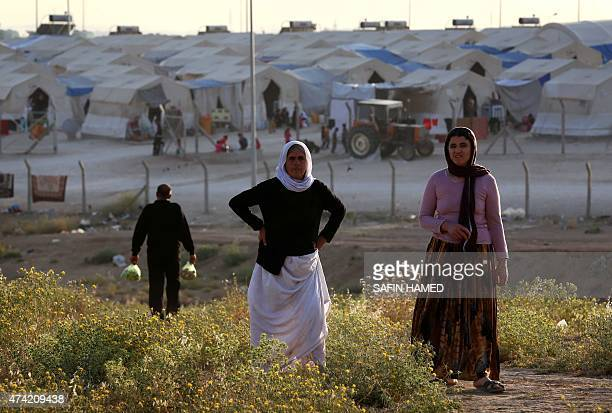 Displaced Iraqis from the Yazidi community who fled violence between Islamic State group jihadists and Peshmerga fighters in the northern Iraqi town...