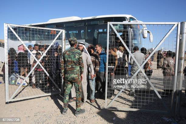 Displaced Iraqis from western Mosul arrive at the Hammam alAlil camp on March 25 as Iraq's elite CounterTerrorism Service retook full control of...