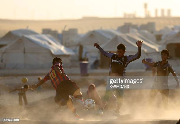 Displaced Iraqis play football during the Muslim holy month of Ramadan at alKhazir camp for the internally displaced located between Arbil and Mosul...