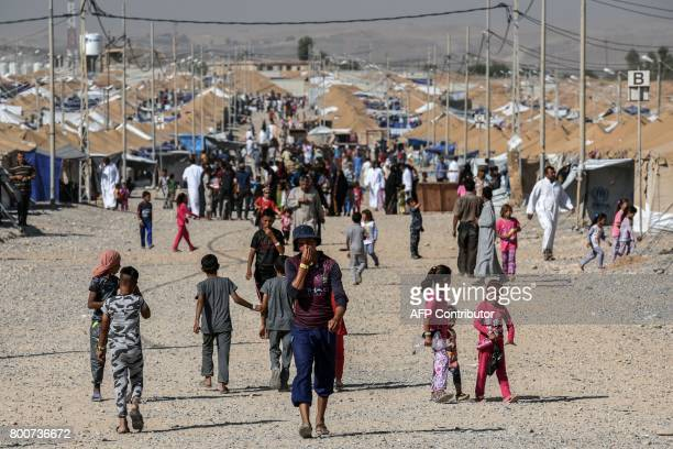 Displaced Iraqis who fled the fighting in Mosul walk at the Salamya camp for internally displaced people, south of the embattled city in the Nimrud...