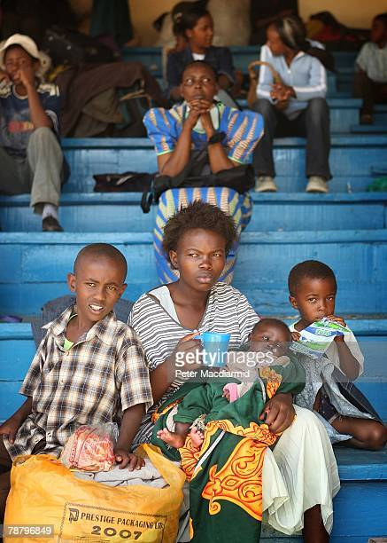 A displaced Kikuyu family eat a meal at the Nakuru show ground on January 7 2008 in Nakuru Kenya Local volunteers and charities are helping thousands...